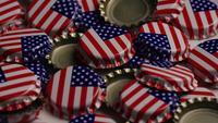 Foto giratoria de tapas de botellas con la bandera americana impresa en ellas - BOTTLE CAPS 033