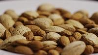 Cinematic, rotating shot of almonds on a white surface - ALMONDS 185