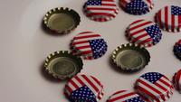 Rotating shot of bottle caps with the American flag printed on them - BOTTLE CAPS 009