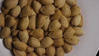 Cinematic, rotating shot of almonds on a white surface - ALMONDS 112