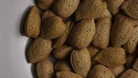 Cinematic, rotating shot of almonds on a white surface - ALMONDS 119