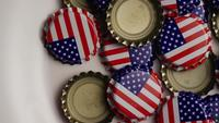 Rotating shot of bottle caps with the American flag printed on them - BOTTLE CAPS 024