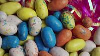 Rotating shot of colorful Easter candies on a bed of easter grass - EASTER 116