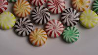 Rotating shot of a colorful mix of various hard candies - CANDY MIXED 004