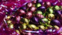 Rotating shot of colorful Easter candies on a bed of easter grass - EASTER 246