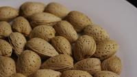 Cinematic, rotating shot of almonds on a white surface - ALMONDS 071