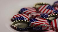 Rotating shot of bottle caps with the American flag printed on them - BOTTLE CAPS 041