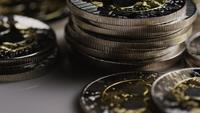 Rotating shot of Bitcoins (digital cryptocurrency) - BITCOIN RIPPLE 0078