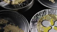 Rotating shot of Bitcoins (digital cryptocurrency) - BITCOIN RIPPLE 0169