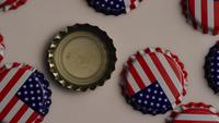 Rotating shot of bottle caps with the American flag printed on them - BOTTLE CAPS 004