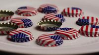 Rotating shot of bottle caps with the American flag printed on them - BOTTLE CAPS 016