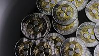 Rotating shot of Bitcoins (digital cryptocurrency) - BITCOIN RIPPLE 0103
