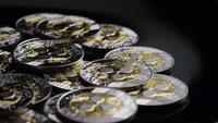 Rotating shot of Bitcoins (digital cryptocurrency) - BITCOIN RIPPLE 0118