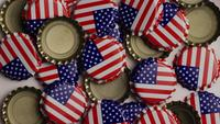 Rotating shot of bottle caps with the American flag printed on them - BOTTLE CAPS 022