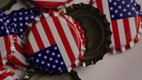 Rotating shot of bottle caps with the American flag printed on them - BOTTLE CAPS 026