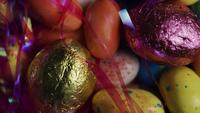 Rotating shot of colorful Easter candies on a bed of easter grass - EASTER 165