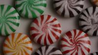 Rotating shot of a colorful mix of various hard candies - CANDY MIXED 008