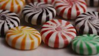 Rotating shot of a colorful mix of various hard candies - CANDY MIXED 019