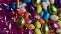 Rotating shot of colorful Easter candies on a bed of easter grass - EASTER 161