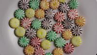 Rotating shot of a colorful mix of various hard candies - CANDY MIXED 001