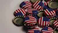 Rotating shot of bottle caps with the American flag printed on them - BOTTLE CAPS 031