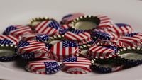 Rotating shot of bottle caps with the American flag printed on them - BOTTLE CAPS 039