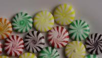 Rotating shot of a colorful mix of various hard candies - CANDY MIXED 003