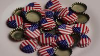 Rotating shot of bottle caps with the American flag printed on them - BOTTLE CAPS 030