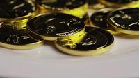 Rotating shot of Titan Bitcoins (digital cryptocurrency) - BITCOIN TITAN 109