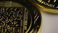 Rotating shot of Titan Bitcoins (digital cryptocurrency) - BITCOIN TITAN 069