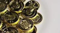 Rotating shot of Titan Bitcoins (digital cryptocurrency) - BITCOIN TITAN 133