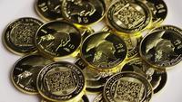 Rotating shot of Titan Bitcoins (digital cryptocurrency) - BITCOIN TITAN 132