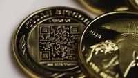 Rotating shot of Titan Bitcoins (digital cryptocurrency) - BITCOIN TITAN 142