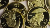 Rotating shot of Titan Bitcoins (digital cryptocurrency) - BITCOIN TITAN 084