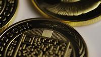 Rotating shot of Titan Bitcoins (digital cryptocurrency) - BITCOIN TITAN 064