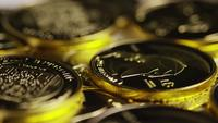 Rotating shot of Titan Bitcoins (digital cryptocurrency) - BITCOIN TITAN 153