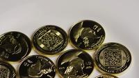 Rotating shot of Titan Bitcoins (digital cryptocurrency) - BITCOIN TITAN 059