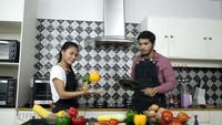 Young couples dancing and prepare food in the kitchen. Happy time.