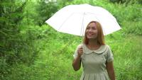 Woman walking hand holding white umbrella at the park