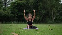 Beautiful woman is doing Yoga in Park