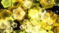 Yellow sparkly pentagonal particles rising