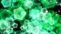 Green sparkly pentagonal particles rising