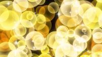 Partículas circulares brillantes amarillas que se levantan