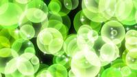 Partículas circulares brillantes verdes que se levantan