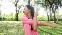 Healthy young asian woman exercising at park.