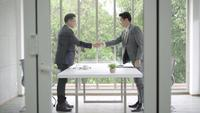 Slow motion - Handshake to seal a deal after a job recruitment meeting.