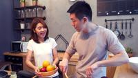 Asian man prepare salad food in the kitchen. Beautiful happy asian couple are cooking in the kitchen.