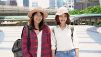 Traveler backpacker Asian women lesbian lgbt couple travel in Bangkok, Thailand.