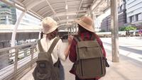 Slow motion - Traveler backpacker Asian women lesbian lgbt couple travel in Bangkok, Thailand.