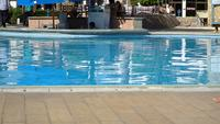 Blue hotel swimming pool. Summer tourism rest. Lounger sunny weather